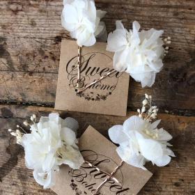 Orquillas en flor preservada en tonos blancos